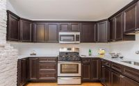 Brown Kitchen Cabinets in Open Environment